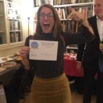 Lucy holding the People's Choice Blue Patch Award