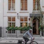 Cyclist & freshly harvested chair outside Secretcape, Mayfair, London - Photo: Secretcape