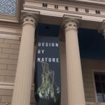 The entrance pillars to the Museum de Fundatie with a poster featuring Full Grown's freshly harvested chair